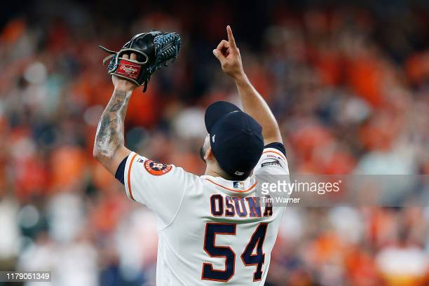 Roberto Osuna of the Houston Astros celebrates after the final out to defeat the Tampa Bay Rays 6-2 in game one of the American League Division...