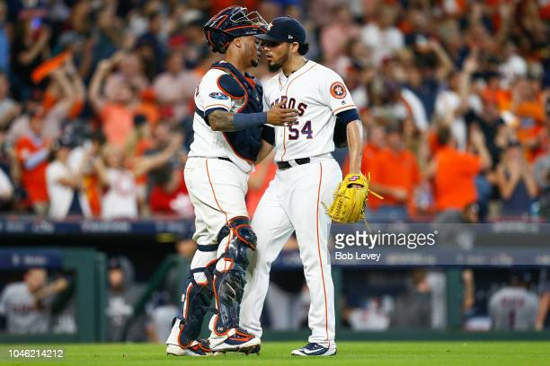 Roberto Osuna of the Houston Astros celebrates with Martin Maldonado after they defeated the Cleveland Indians 72 in Game One of the American League...