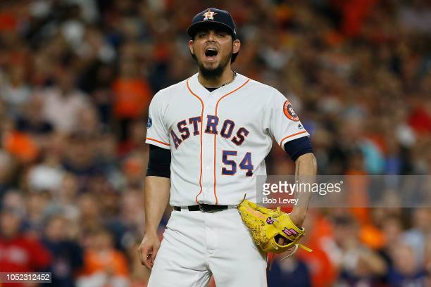Roberto Osuna of the Houston Astros reacts after walking Mitch Moreland of the Boston Red Sox and scoring Steve Pearce in the eighth inning during...