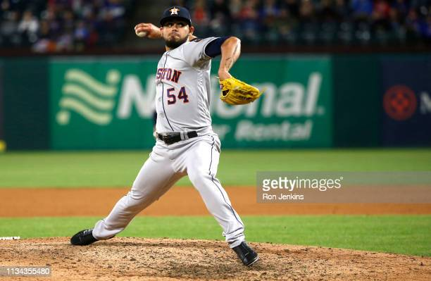 Roberto Osuna of the Houston Astros throws against the Texas Rangers during the ninth inning at Globe Life Park in Arlington on April 1 2019 in...