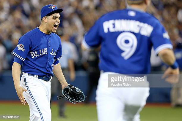 Roberto Osuna of the Toronto Blue Jays celebrates after the Blue Jays 63 victory against the Texas Rangers in game five of the American League...