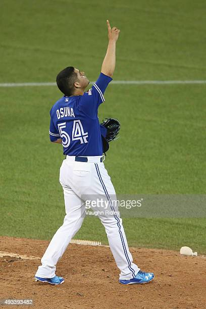 Roberto Osuna of the Toronto Blue Jays celebrates defeating the Kansas City Royals 118 in game three of the American League Championship Series at...