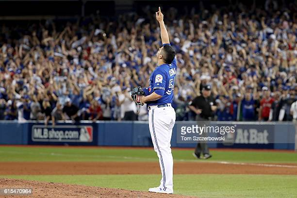 Roberto Osuna of the Toronto Blue Jays celebrates in the ninth inning against the Cleveland Indians during game four of the American League...