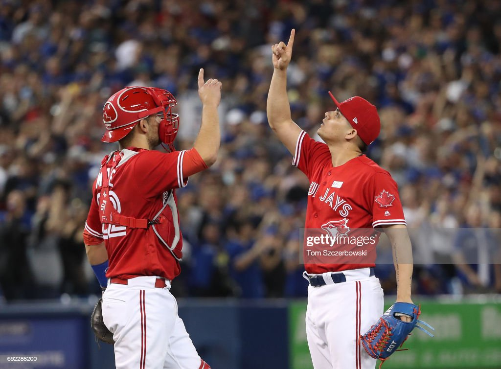 Roberto Osuna #54 of the Toronto Blue Jays celebrates their victory with Luke Maile #22 during MLB game action against the New York Yankees at Rogers Centre on June 4, 2017 in Toronto, Canada.