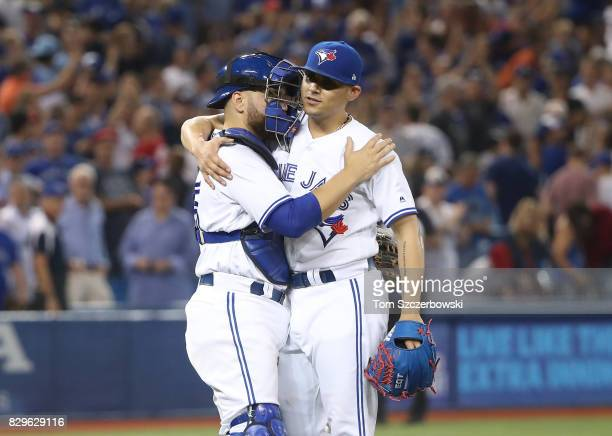 Roberto Osuna of the Toronto Blue Jays celebrates their victory with Russell Martin during MLB game action against the New York Yankees at Rogers...