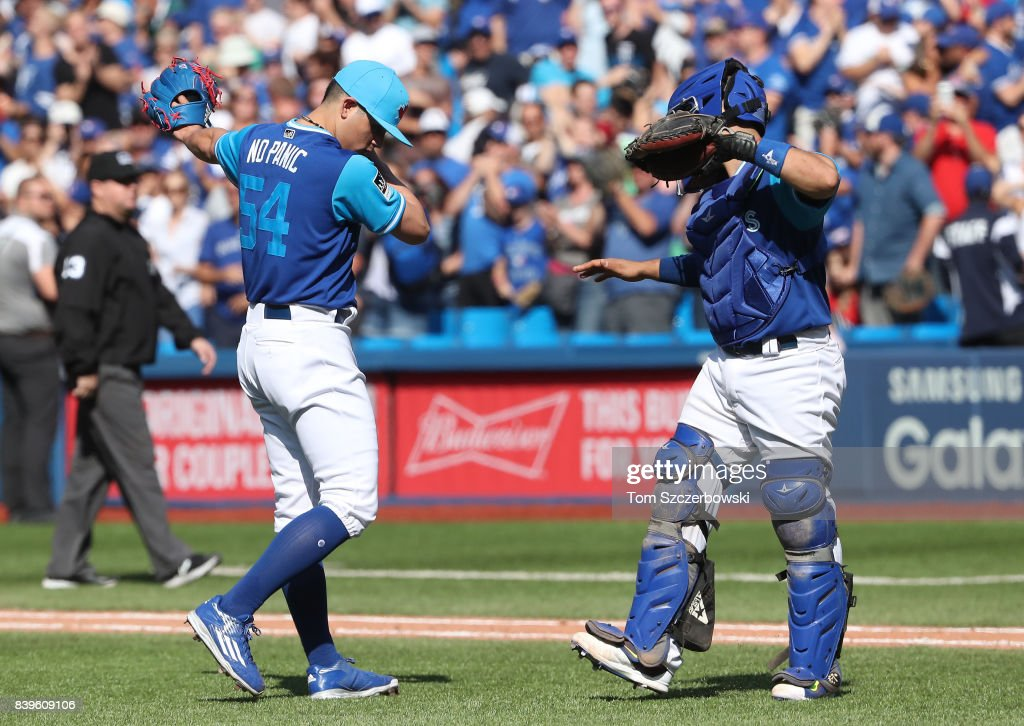 Roberto Osuna #54 of the Toronto Blue Jays celebrates their victory with Raffy Lopez #1 during MLB game action against the Minnesota Twins at Rogers Centre on August 26, 2017 in Toronto, Canada.