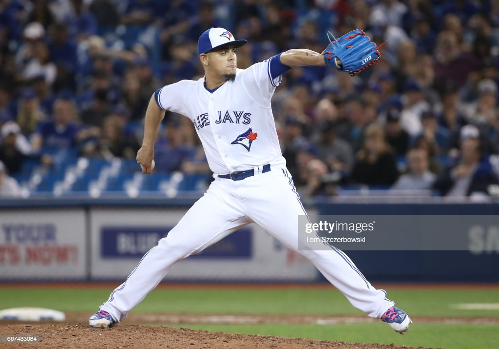 Roberto Osuna #54 of the Toronto Blue Jays delivers a pitch in the ninth inning during MLB game action against the Milwaukee Brewers at Rogers Centre on April 11, 2017 in Toronto, Canada.