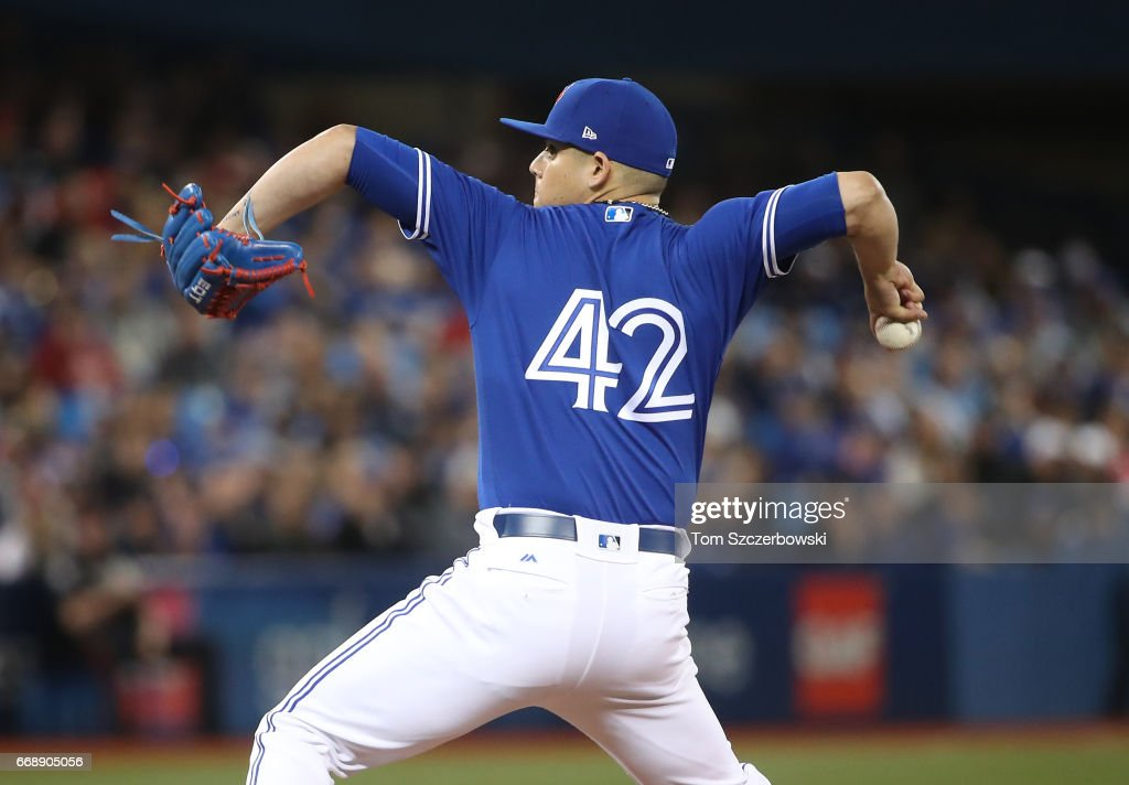 Roberto Osuna #54 of the Toronto Blue Jays delivers a pitch in the ninth inning during MLB game action against the Baltimore Orioles at Rogers Centre on April 15, 2017 in Toronto, Canada. All players are wearing #42 in honor of Jackie Robinson Day.