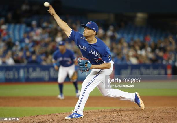 Roberto Osuna of the Toronto Blue Jays delivers a pitch in the ninth inning during MLB game action against the New York Yankees at Rogers Centre on...