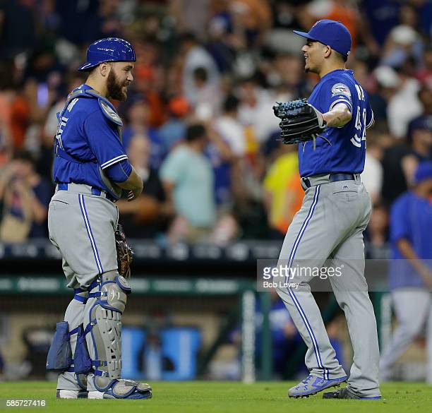 Roberto Osuna of the Toronto Blue Jays hugs catcher Russell Martin after the final out against the Houston Astros at Minute Maid Park on August 3...
