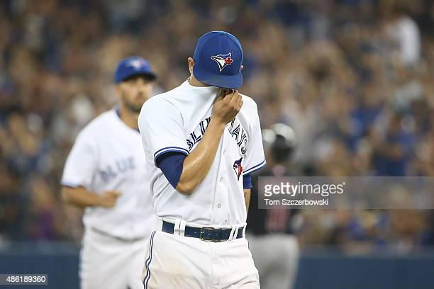 Roberto Osuna of the Toronto Blue Jays reacts after blowing a save at the end of the ninth inning during MLB game action against the Cleveland...