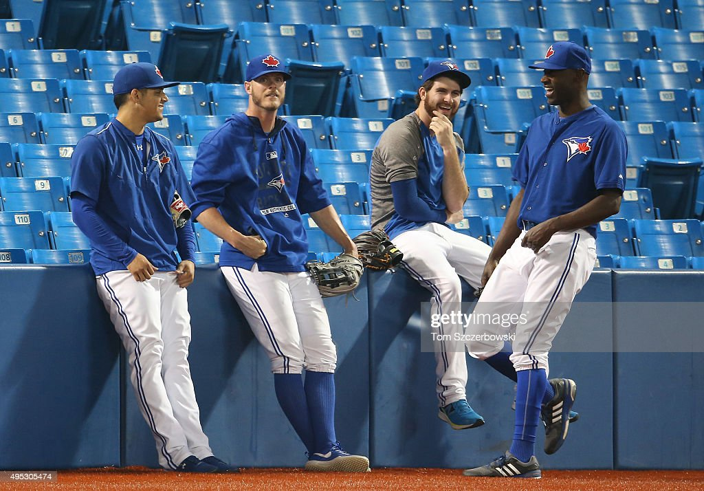 Roberto Osuna #54 of the Toronto Blue Jays shares a laugh with Mark Lowe #57 and Drew Hutchison #36 and LaTroy Hawkins #32 during batting practice before MLB game action against the Boston Red Sox on September 19, 2015 at Rogers Centre in Toronto, Ontario, Canada.