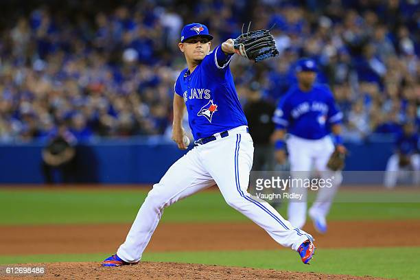 Roberto Osuna of the Toronto Blue Jays throws a pitch in the ninth inning against the Baltimore Orioles during the American League Wild Card game at...