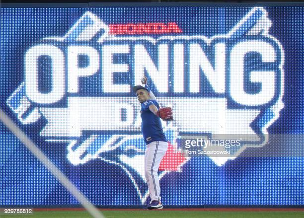 Roberto Osuna of the Toronto Blue Jays warms up in the outfield on Opening Day before their MLB game against the New York Yankees at Rogers Centre on...