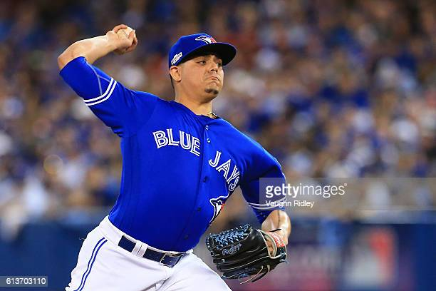 Roberto Osuna of the Toronto Blue Jays works against the Texas Rangers in the ninth inning during game three of the American League Division Series...