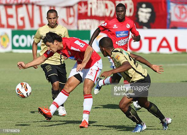 Roberto Ovelar of Juan Aurich fights for the ball with Ervin Maturana of Itagui during a match between Juan Aurich and Itagui as part of The Copa...