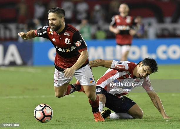 Roberto Ovelar of Junior struggles for the ball with Diego of Flamengo during a second leg match between Junior and Flamengo as part of the Copa...