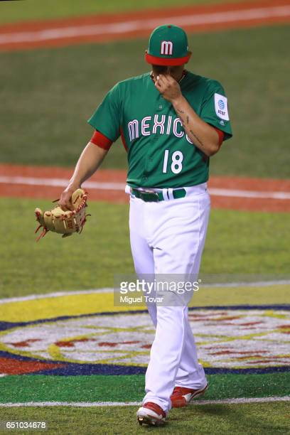 Roberto Ozuna of Mexico reacts after leaves the field in the bottom of the ninth inning during the World Baseball Classic Pool D Game 1 between Italy...