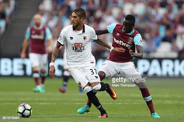 Roberto Pereya of Watford is put under pressure from Cheikhou Kouyate of West Ham United during the Premier League match between West Ham United and...