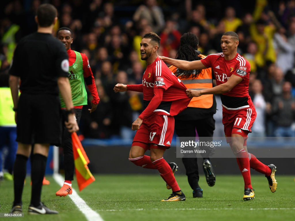 Roberto Pereyra celebrates scoring his side's second goal with Richarlison de Andrade of Watford during the Premier League match between Chelsea and Watford at Stamford Bridge on October 21, 2017 in London, England.