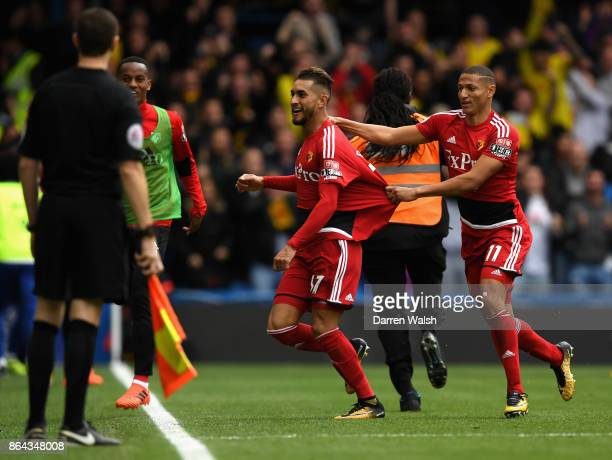 Roberto Pereyra celebrates scoring his side's second goal with Richarlison de Andrade of Watford during the Premier League match between Chelsea and...