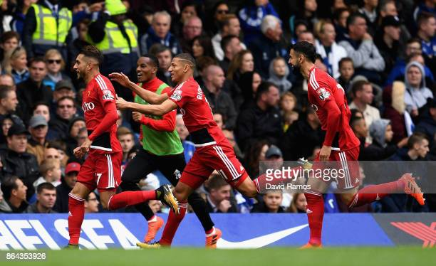Roberto Pereyra celebrates scoring his side's second goal with Richarlison de Andrade of Watford and Miguel Britos of Watford during the Premier...