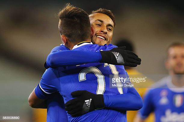 Roberto Pereyra of Juventus hugs Paulo Dybala of Juventus whi kicked a goal during the 2016 International Champions Cup match between Juventus FC and...