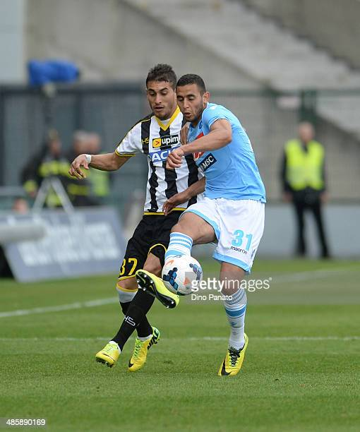 Roberto Pereyra of Udinese Calcio competes with Faouzi Ghoulam of SSC Napoli during the Serie A match between Udinese Calcio and SSC Napoli at Stadio...