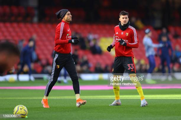 Roberto Pereyra of Watford and Ignacio Pussetto of Watford warmup ahead of the Premier League match between Watford FC and Tottenham Hotspur at...