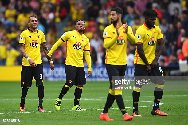 Roberto Pereyra of Watford and Juan Camilo Zuniga of Watford embrace after the game during the Premier League match between Watford and Manchester...