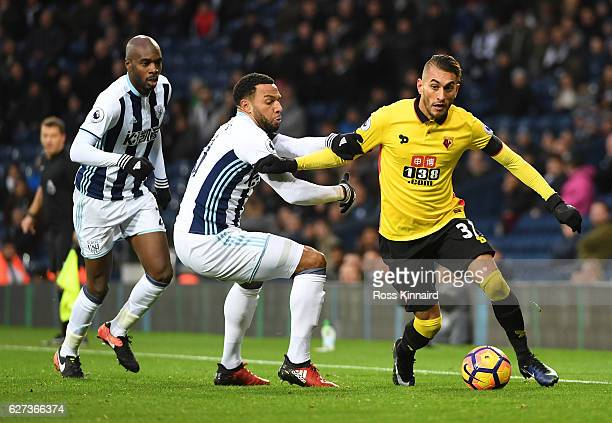 Roberto Pereyra of Watford and Matt Phillips of West Bromwich Albion compete for the ball during the Premier League match between West Bromwich...