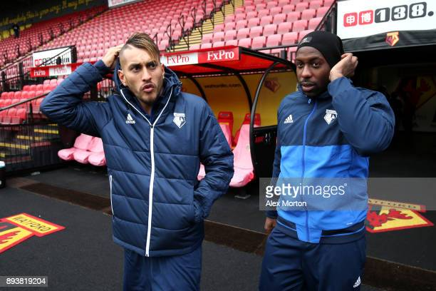Roberto Pereyra of Watford and Stefano Okaka of Watford walk out of the tunnel prior to the Premier League match between Watford and Huddersfield...