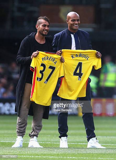 Roberto Pereyra of Watford and Younes Kaboul of Watford are presented to the Watford fans during the Premier League match between Watford and Chelsea...