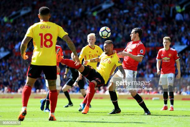 Roberto Pereyra of Watford attempts an overhead kick past Matteo Darmian of Man Utd during the Premier League match between Manchester United and...