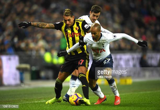 Roberto Pereyra of Watford battles for possession with Lucas Moura and Harry Winks of Tottenham Hotspur during the Premier League match between...