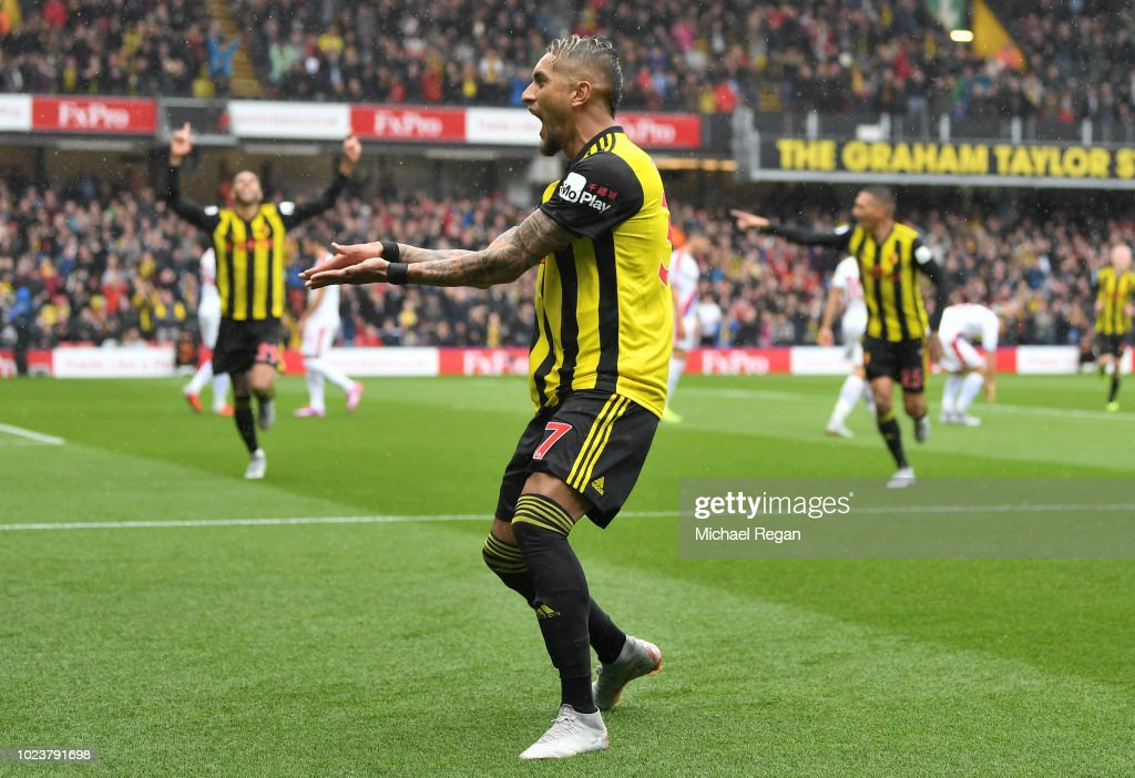 Roberto Pereyra of Watford celebrates after scoring his team's first goal during the Premier League match between Watford FC and Crystal Palace at Vicarage Road on August 26, 2018 in Watford, United Kingdom.