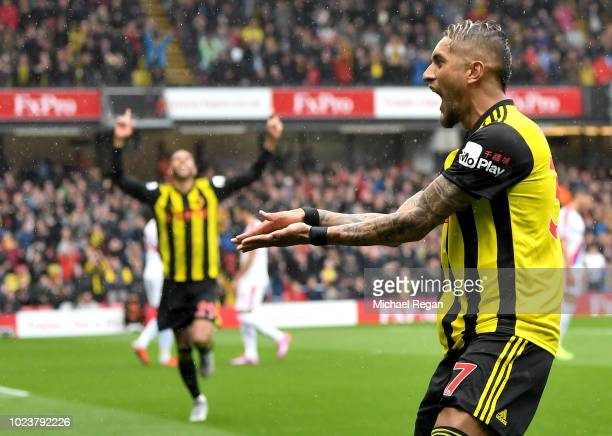 Roberto Pereyra of Watford celebrates after scoring his team's first goal during the Premier League match between Watford FC and Crystal Palace at...