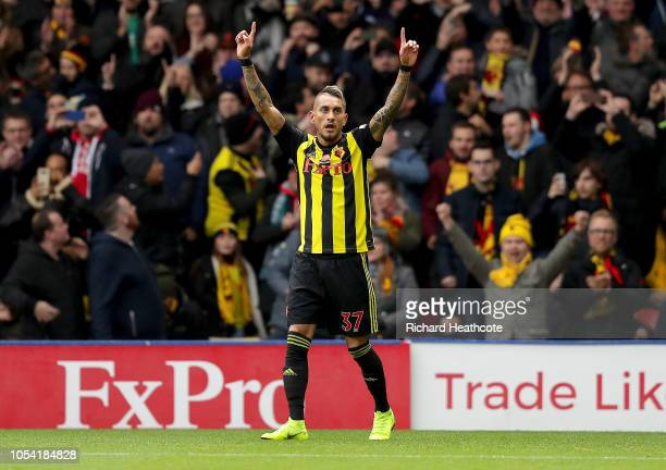 Roberto Pereyra of Watford celebrates after scoring his team's first goal during the Premier League match between Watford FC and Huddersfield Town at...
