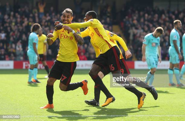 Roberto Pereyra of Watford celebrates after scoring with Abdoulaye Doucoure of Watford and Will Hughes of Watford during the Premier League match...