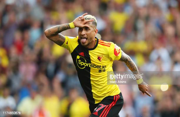 Roberto Pereyra of Watford celebrates as he scores his team's second goal from a penalty during the Premier League match between Watford FC and...