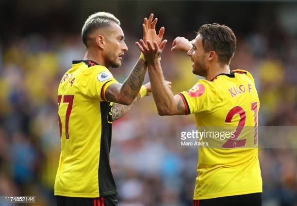 Roberto Pereyra of Watford celebrates as he scores his team's second goal from a penalty with Kiko Femenia during the Premier League match between...