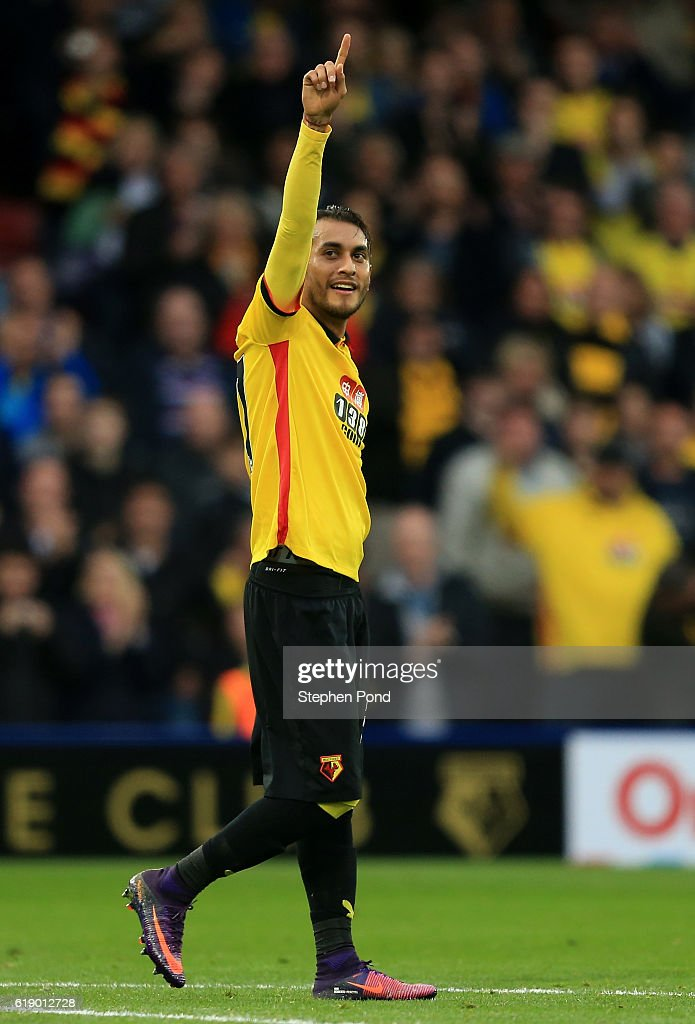 Roberto Pereyra of Watford (C) celebrates his sides first goal during the Premier League match between Watford and Hull City at Vicarage Road on October 29, 2016 in Watford, England.