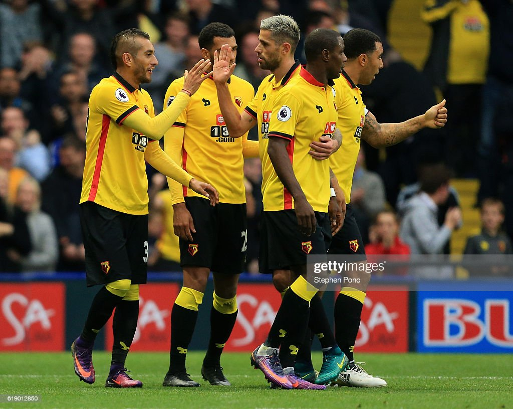 Roberto Pereyra of Watford (L) celebrates his sides first goal with his Watford team mates during the Premier League match between Watford and Hull City at Vicarage Road on October 29, 2016 in Watford, England.