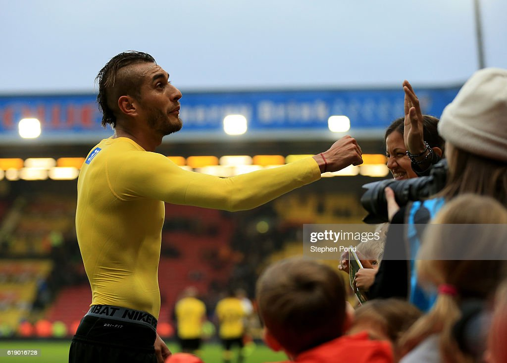 Roberto Pereyra of Watford celebrates his team's 1-0 win with supporters after the Premier League match between Watford and Hull City at Vicarage Road on October 29, 2016 in Watford, England.
