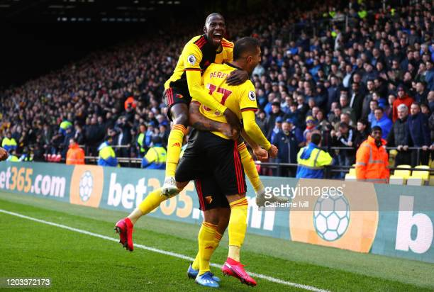 Roberto Pereyra of Watford celebrates with Abdoulaye Doucoure after scoring his team's second goal during the Premier League match between Watford FC...