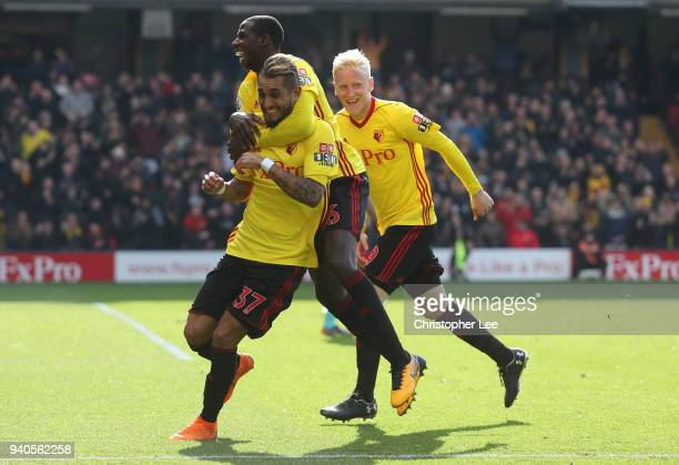 Roberto Pereyra of Watford celebrates with teammates Abdoulaye Doucoure and Will Hughes after scoring his sides second goal during the Premier League...