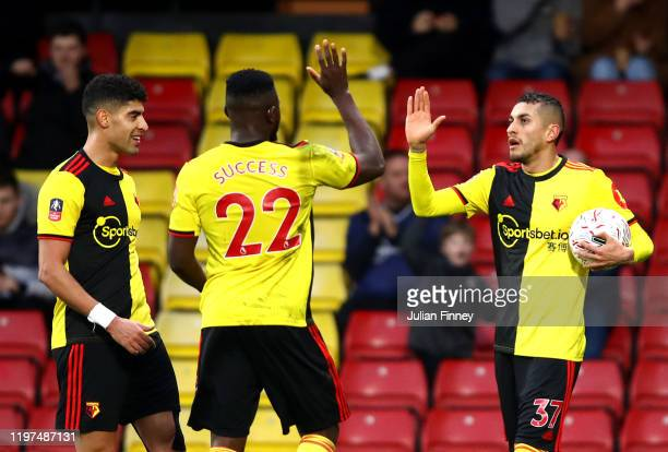 Roberto Pereyra of Watford celebrates with teammates after scoring his team's third goal during the FA Cup Third Round match between Watford FC and...