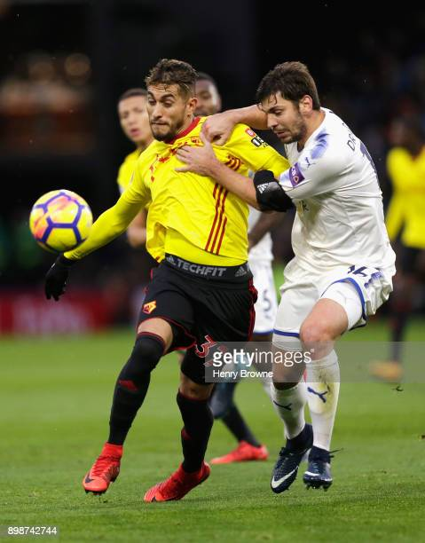 Roberto Pereyra of Watford is challenged by Aleksander Dragovic of Leicester City during the Premier League match between Watford and Leicester City...