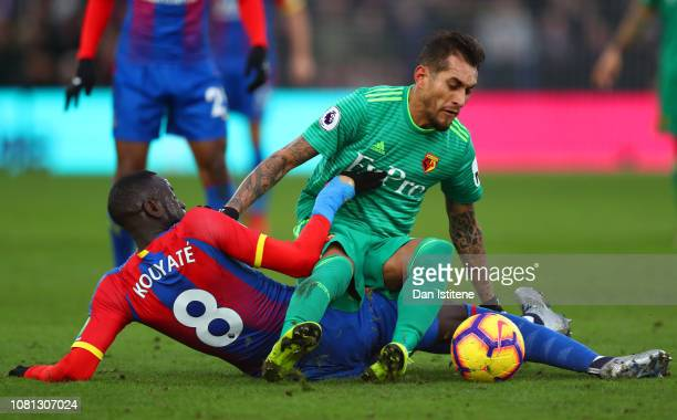 Roberto Pereyra of Watford is challenged by Cheikhou Kouyate of Crystal Palace during the Premier League match between Crystal Palace and Watford FC...