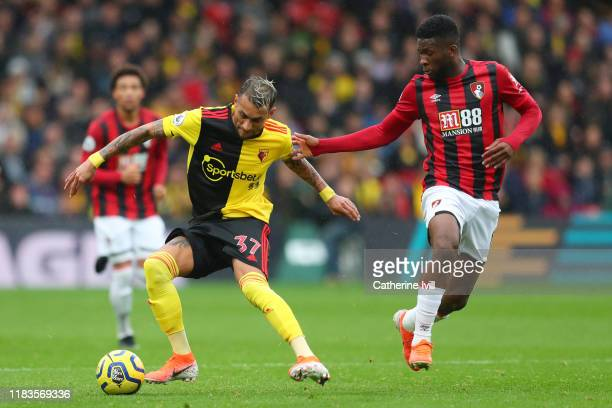 Roberto Pereyra of Watford is challenged by Jefferson Lerma of AFC Bournemouth during the Premier League match between Watford FC and AFC Bournemouth...